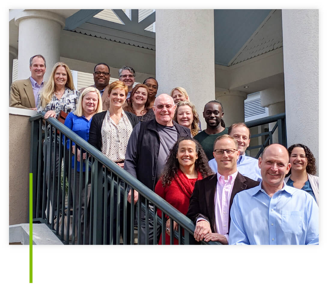 The We Are Sharing Hope SC Board of Directors smiling and standing on stairs outside of a building.
