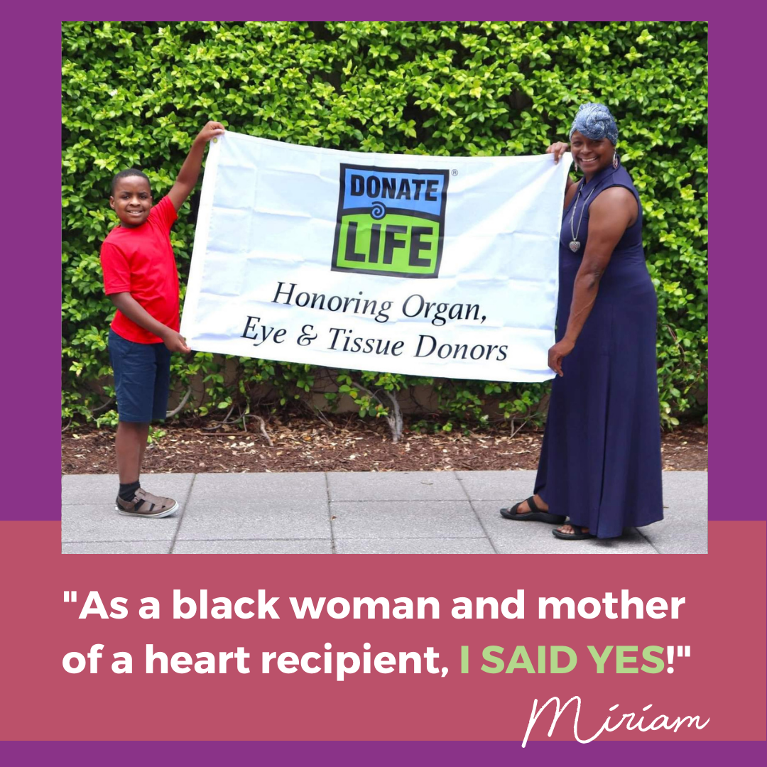 """Miriam and young son smiling while holding Donate Life banner and quote, """"As a black woman and mother of a heart recipient, I SAID YES!"""""""